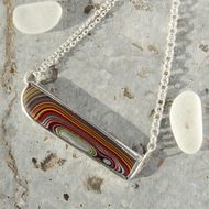 Asymmetric corvette fordite and sterling silver necklace