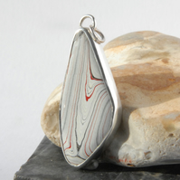 Sterling silver and freeform fordite pendant