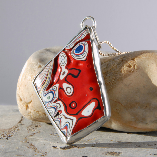 Reversible red fordite and sterling silver pendant
