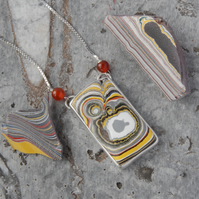 Monster fordite and sterling silver pendant