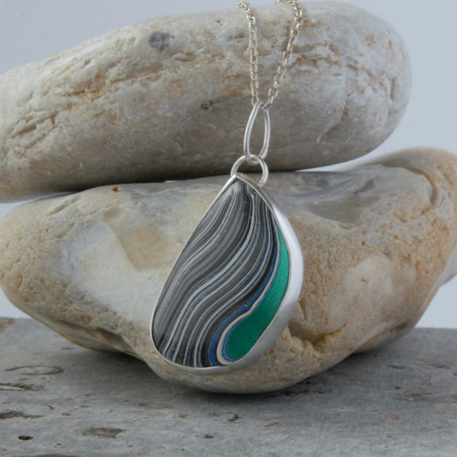 Sterling silver and modern fordite pendant
