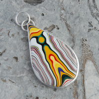 Sterling silver and unusual yellow fordite pendant