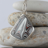 SALE - Sparkly fordite and sterling silver pendant