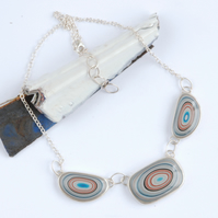 triple bullseye fordite and sterling silver necklace