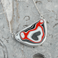 Statement red and black fordite and sterling silver necklace