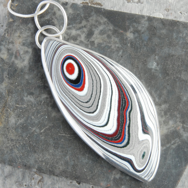 Sterling silver and fordite 'feather ' pendant