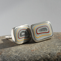 Red and yellow oblong fordite and sterling silver swivel back cufflinks