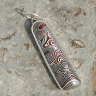 Monochrome Fordite and silver pendant
