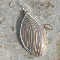 Unisex fordite and sterling silver pendant