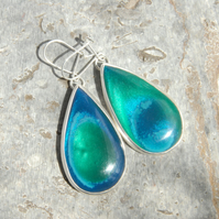Large 'wave' bowlerite and sterling silver drop earrings