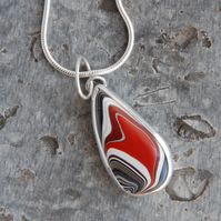 Small red fordite and silver pendant