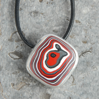 Red Harley fordite pendant