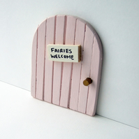 Pale pink fairy door
