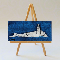 Miniature painting of a lighthouse
