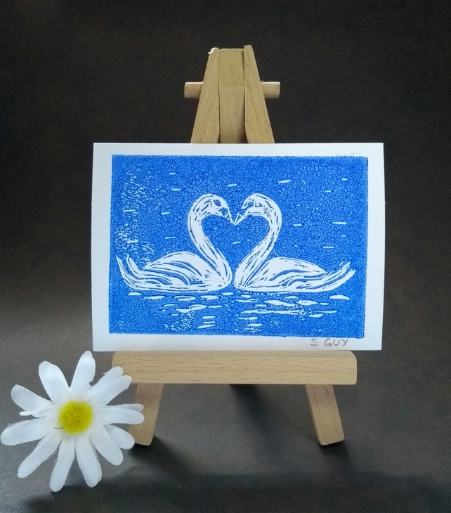 Original love swans linocut in blue