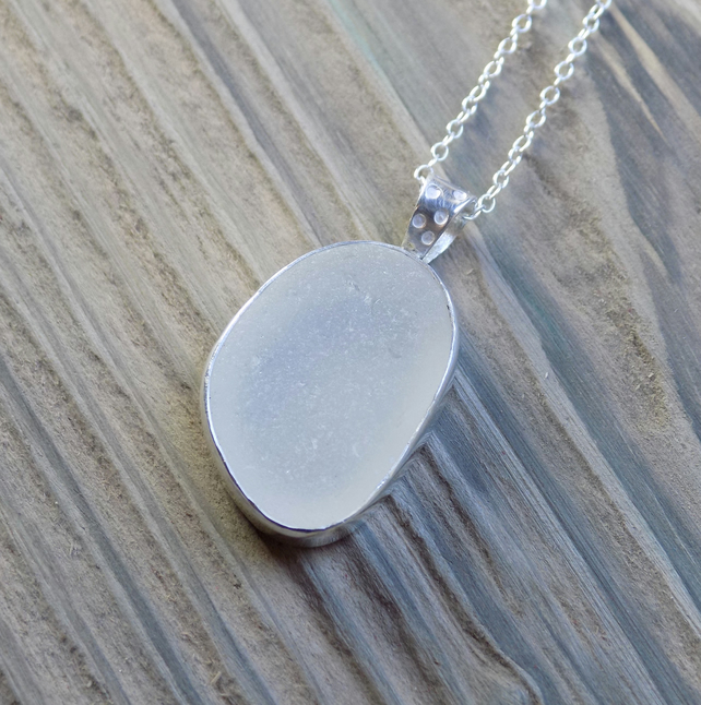 Sea glass and sterling silver bezel set pendant