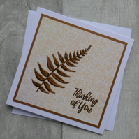 Brown Embossed Fern with Peach Swirl Background 'Thinking of You' Card