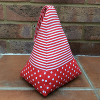 Red pyramid doorstop