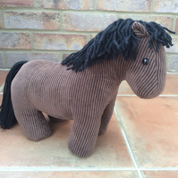 Pepper, pony doorstop