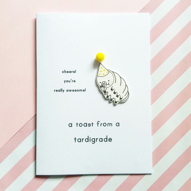 congratulations card - a toast from a tardigrade - yellow pom pom hat