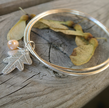 Sterling silver bangle with fine silver oak leaf and freshwater pearl
