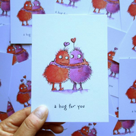 "A6 Monster ""a hug for you"" Postcard"