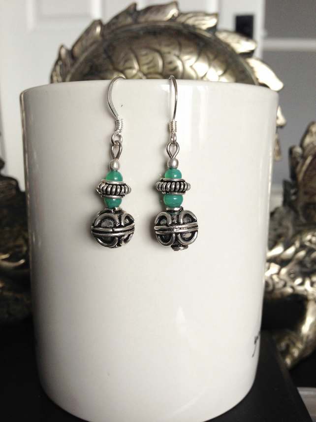 Silver ball green earrings
