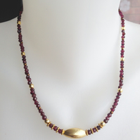 Garnet with gold necklace