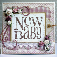 New baby girl card with pull-out tag