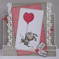 Handmade card featuring dog with heart balloon