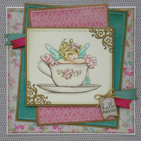 Vintage style card featuring fairy in a teacup