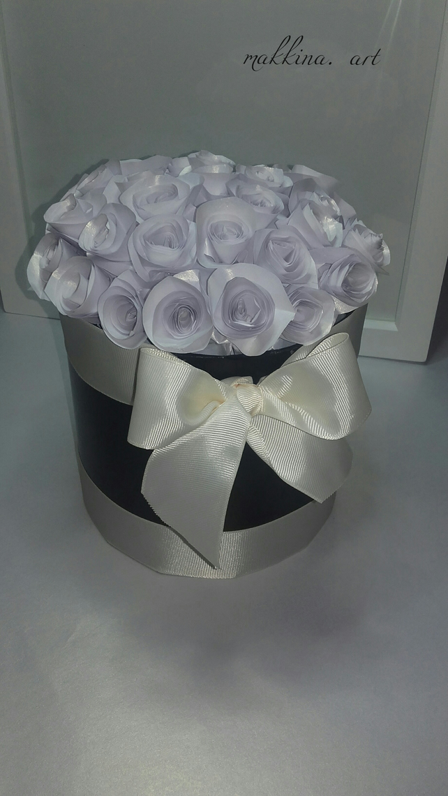 Paper bouquet of white roses