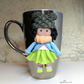 Polymer clay doll figure decorated mug