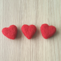 Needle felted heart magnets