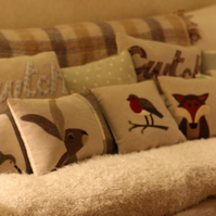 Handmade Robin cushion made with wool and linen