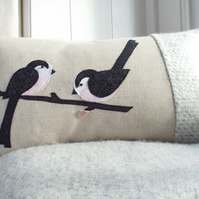 Longtailed tit and blossom cushion with wool woven in Wales.