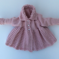 Hand knitted matinee coat in merino wool