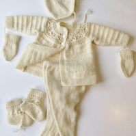Cashmere pramsuit hand knitted to order