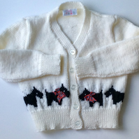 Baby cardigan hand knitted with scottie dog border