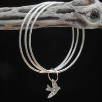 Silver bangles linked with gold - silver bird dangle - hallmarked - yoga bangle