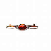 sterling silver brooch with honey baltic amber