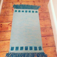 Turquoise squares rug