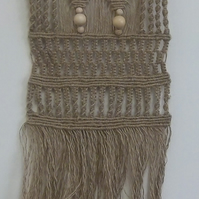 Macrame wall hanging made with dyed jute twine, wooden beads and bamboo