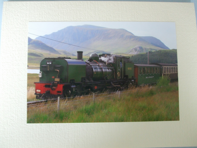 Photographic greetings card of a green steam train.