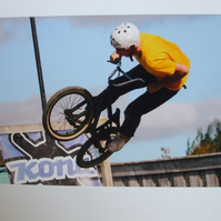 Photographic greetings card of a BMX bike rider.