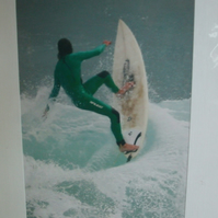 Photographic greetings card of a surfer about to 'Wipeout'.