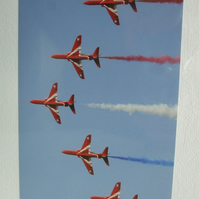 Photographic greetings card of the Red Arrows,  trailing red, white & blue smoke