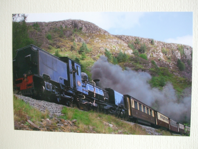 Photographic greetings card of a Welsh Highland Railway steam train in black.