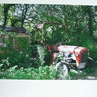 Photographic card of an old tractor.