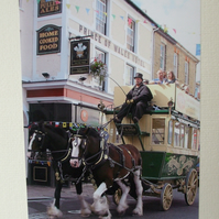 Photographic greetings card of a Horse Drawn Bus outside a hotel.
